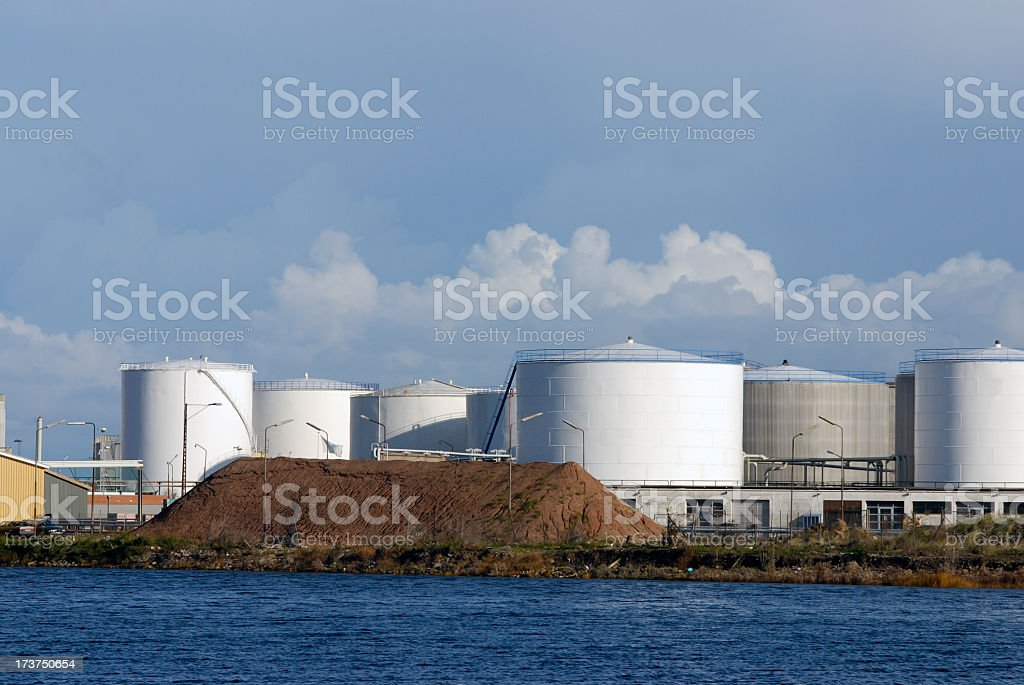 Storage siloes and heap of soil royalty-free stock photo