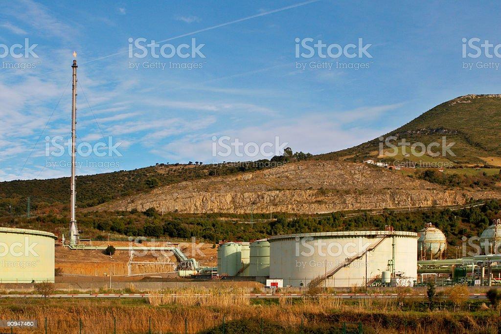 Storage tanks and chimney royalty-free stock photo