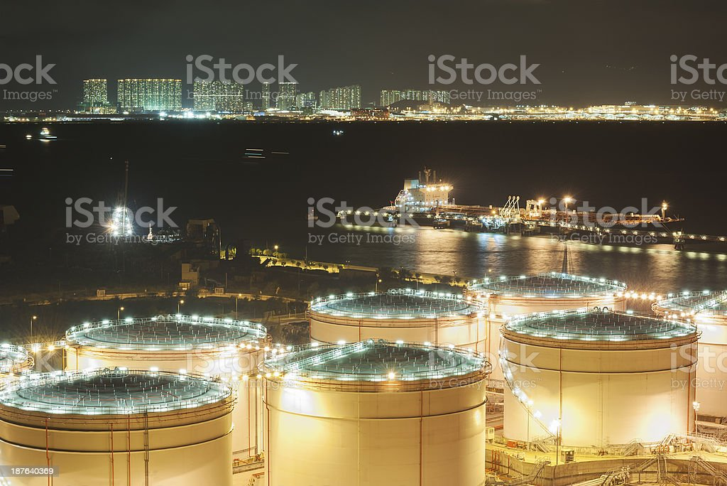 Storage tanks at a power station at nighttime stock photo