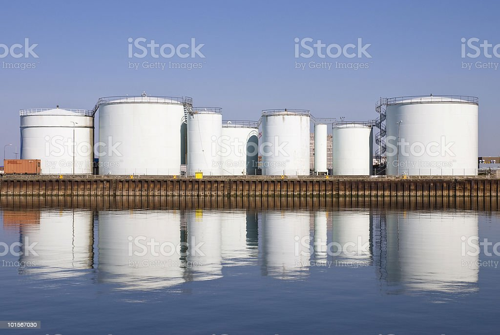 Storage tanks at harbor stock photo