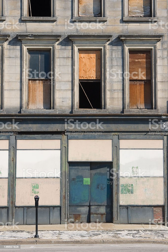 Store Building Boarded Up and Closed, Abandoned City Property stock photo