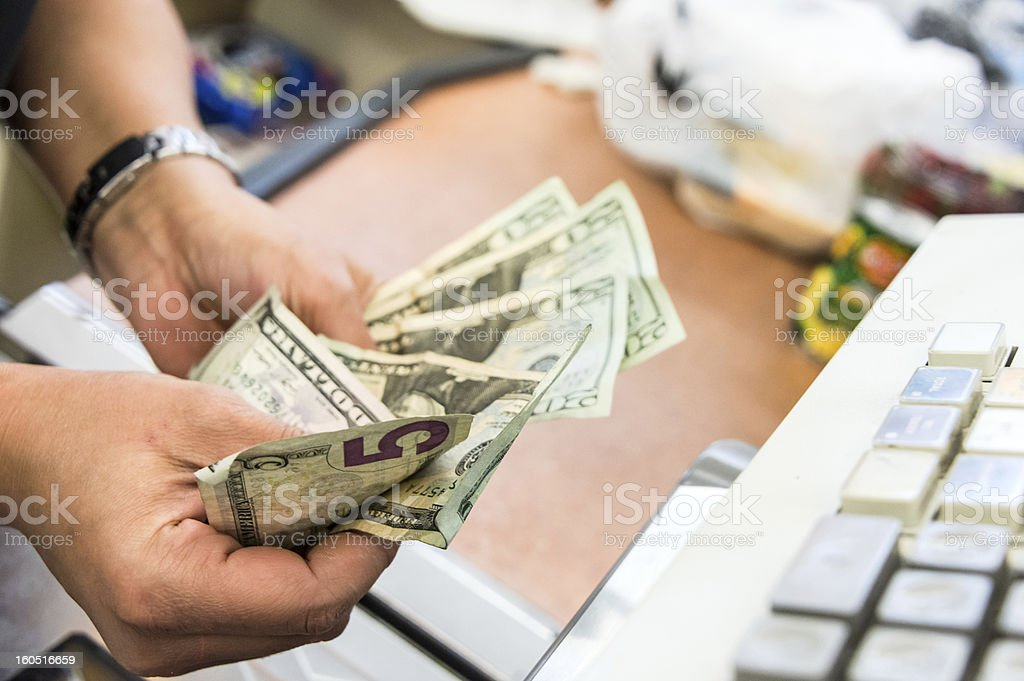 Store cashier counting the cash royalty-free stock photo