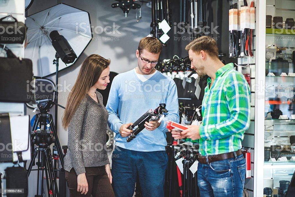 Store clerk selling photographic equipment stock photo