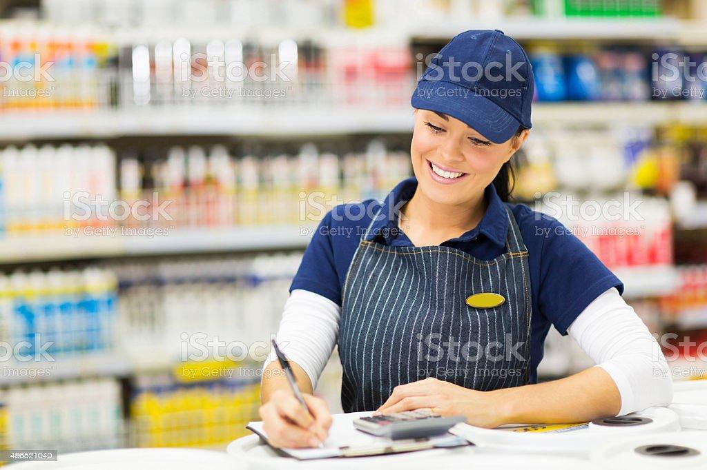 store clerk writing stock stock photo