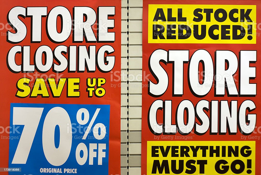 Store closing, window signs royalty-free stock photo