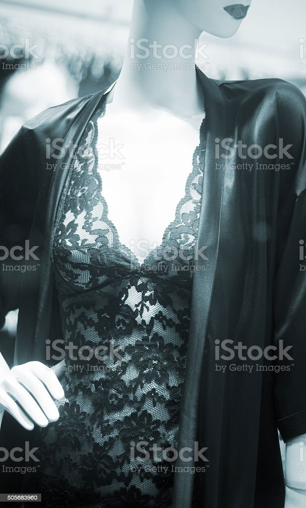 Store clothes dummy in women's clothing shop stock photo