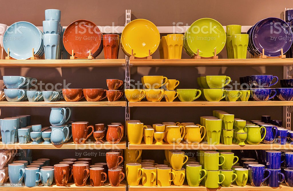Store display of colorful tableware on the shelves. stock photo
