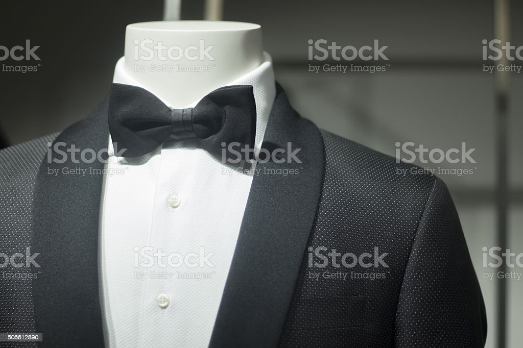 Store dummy in dinner jacket and bow tie stock photo