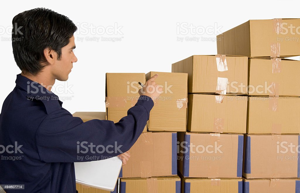 Store in charge counting cardboard boxes stock photo