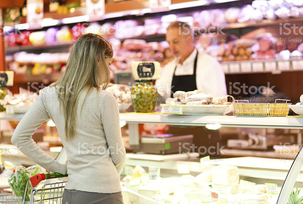 Store keeper serving a customer royalty-free stock photo