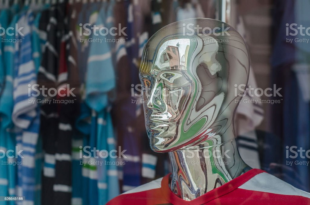store male mannequin in chrome face stock photo