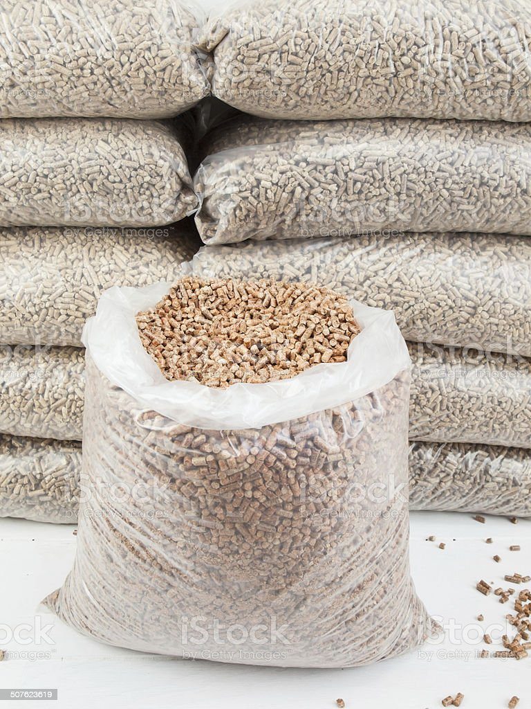 store of wood pellets stock photo