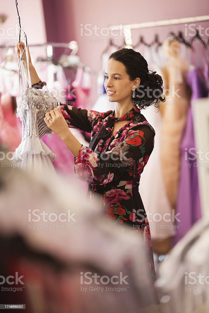 Store Owner Examining Evening Gown royalty-free stock photo