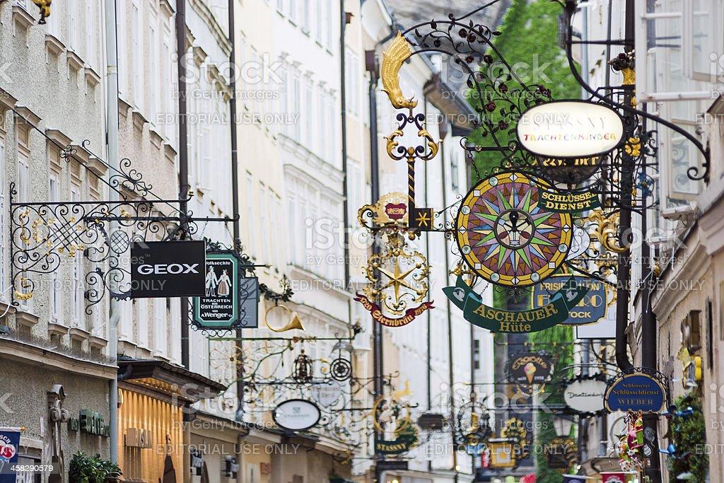 Store signs along Getreidegasse in Salzburg, Austria stock photo