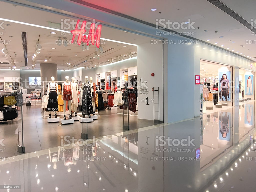 HM Store vs Uniqlo Stores in Guangzhou stock photo