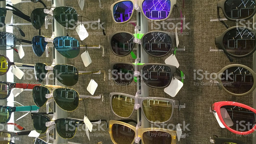 Store with different sunglasses models stock photo