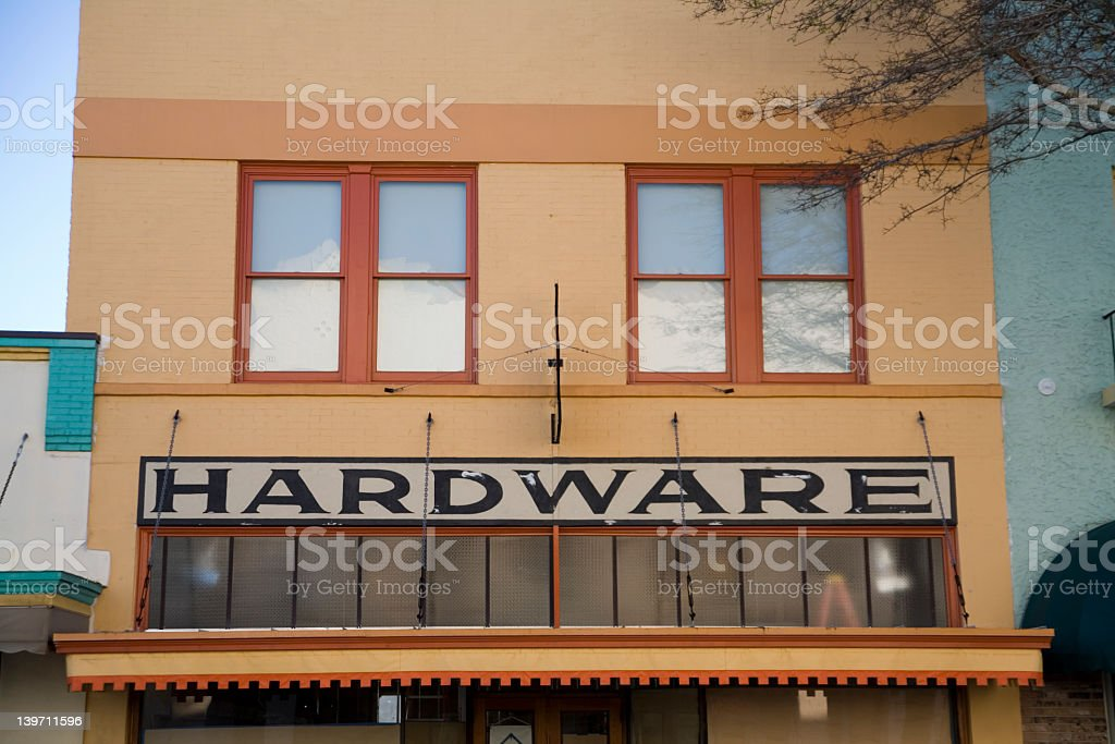 A storefront photo of a hardware store royalty-free stock photo