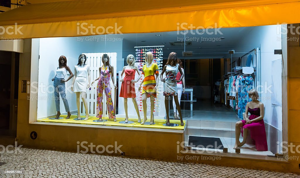 Storefront with women-mannequins stock photo