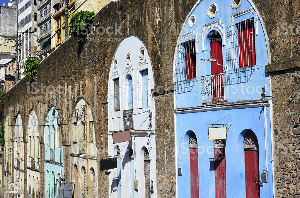 Stores and houses nested in the arches of a viaduct royalty-free stock photo