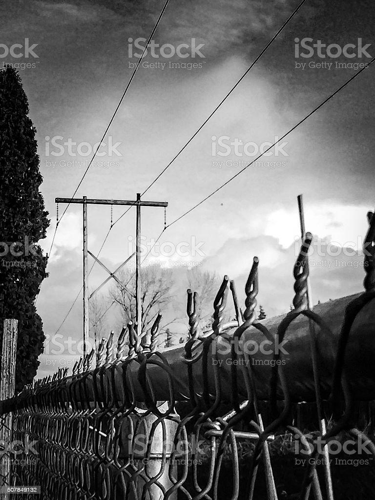 Storm across the fenceline stock photo