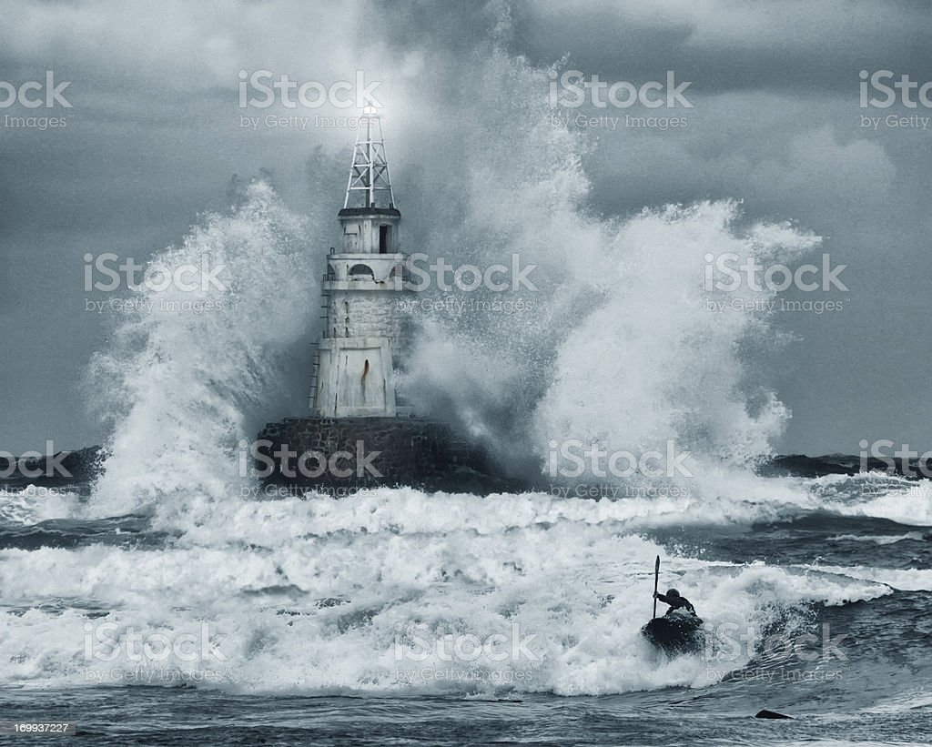 Storm and lighthouse stock photo