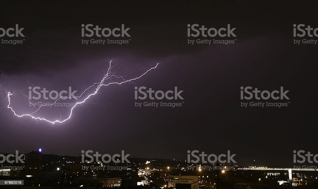 storm and lightning over city stock photo