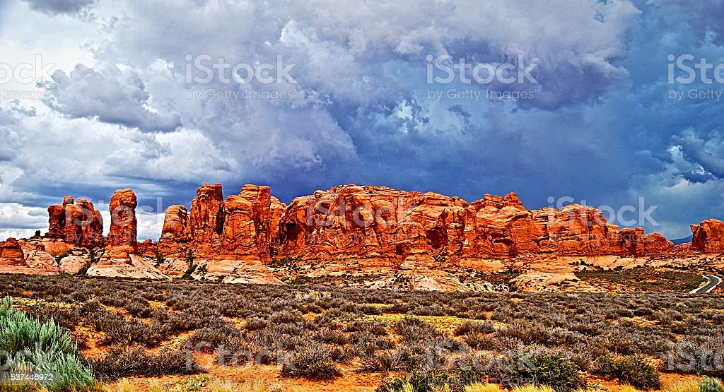 Storm approaching over desert rock formation stock photo