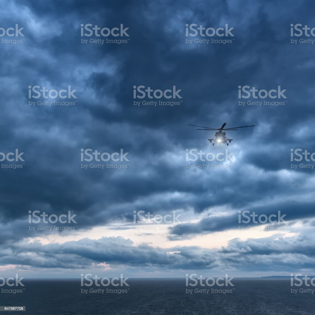 Storm at sea, helicopter from below in front dramatic sky, stormy sky stock photo