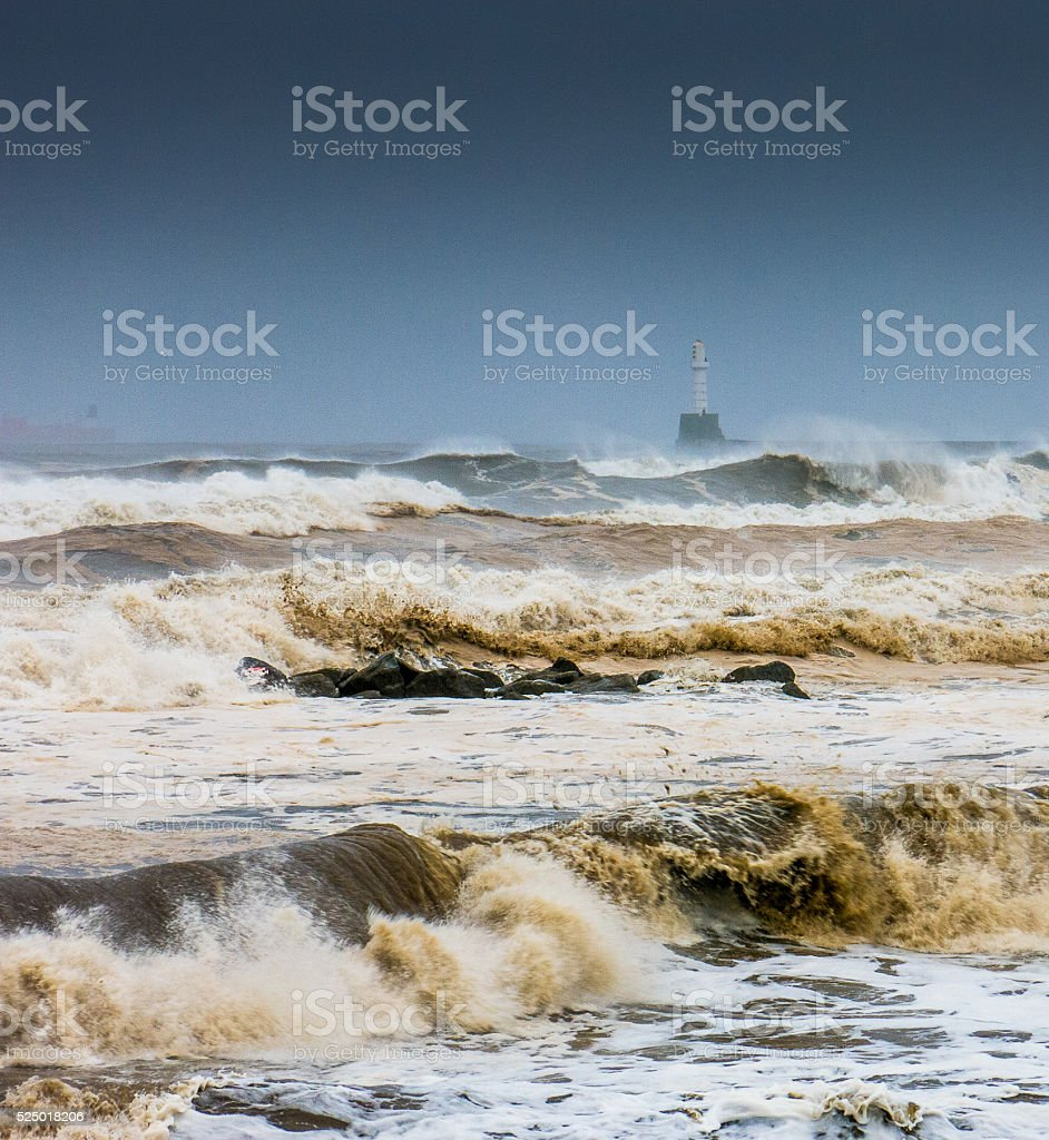 Storm Churns North Sea at Aberdeen near Lighthouse UK stock photo