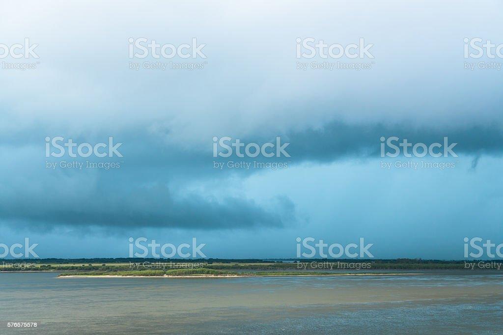 Storm Cloud over Amur River stock photo