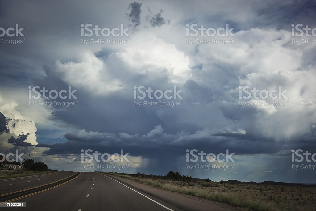 storm cloud road trip stock photo