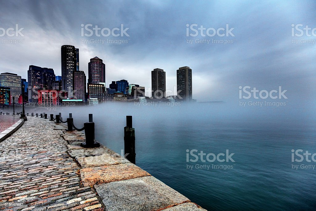 Storm clouds and fog approaching Downtown Boston, Massachusetts stock photo