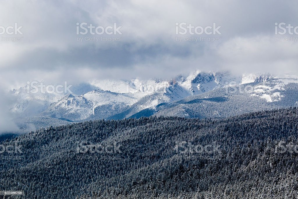 Storm Clouds and Snow on Pikes Peak stock photo