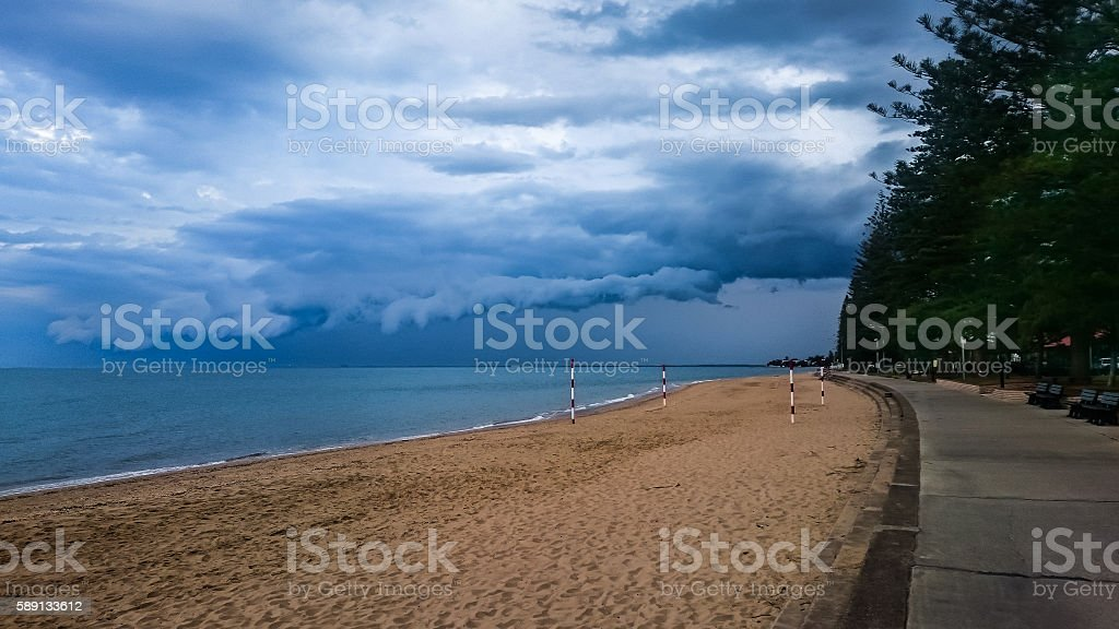 Storm clouds at beach on boardwalk stock photo