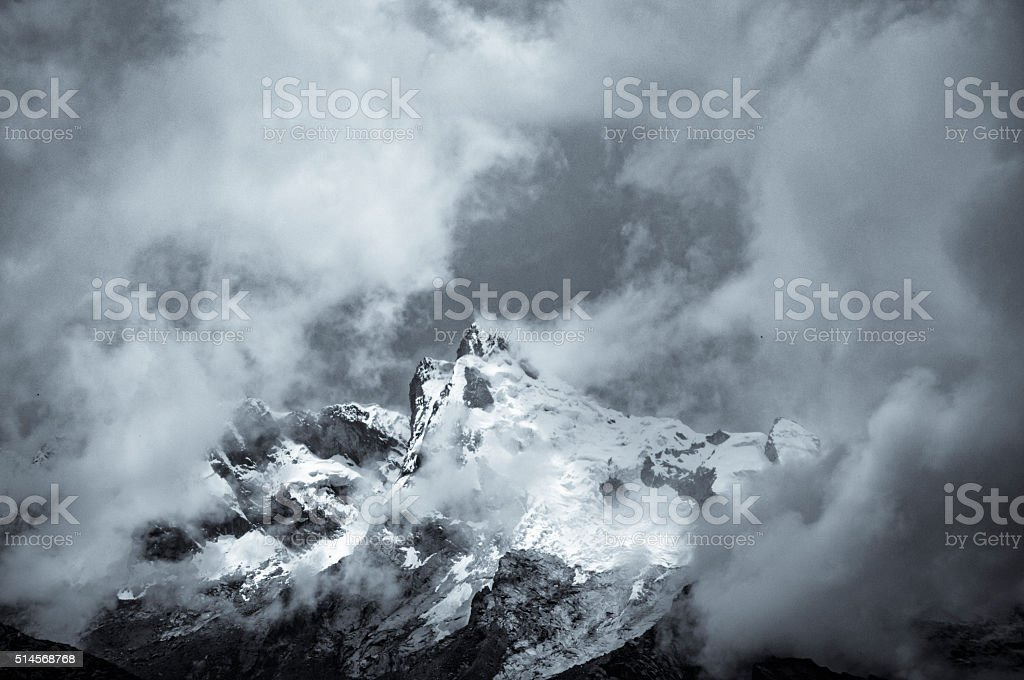 Storm Clouds Gather Around A Mountain Near Huaraz In Peru stock photo