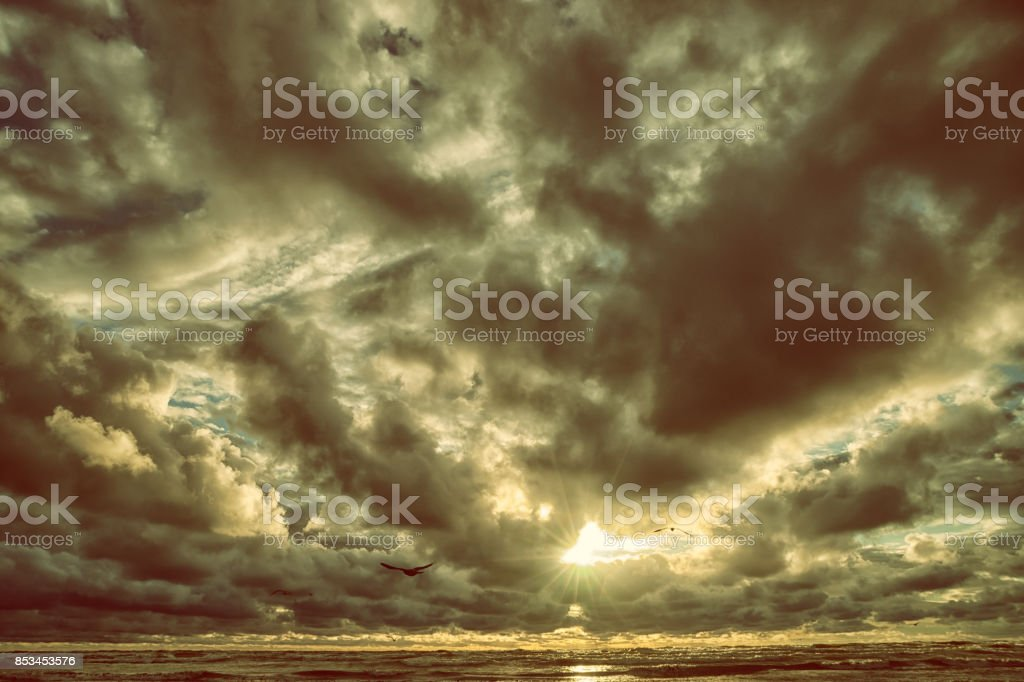 Storm clouds gather over the sea stock photo
