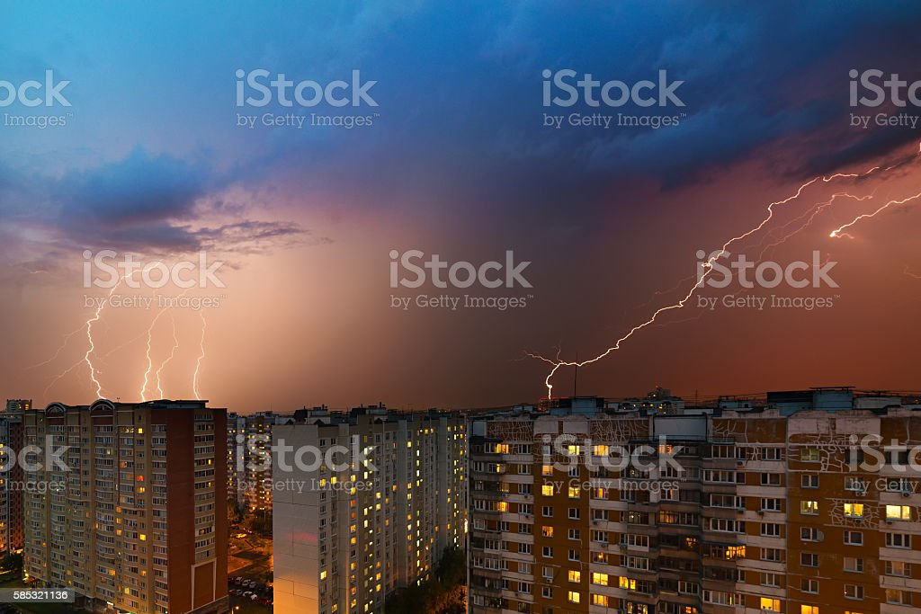 Storm clouds, heavy rain. Thunderstorm and lightning over the city. stock photo