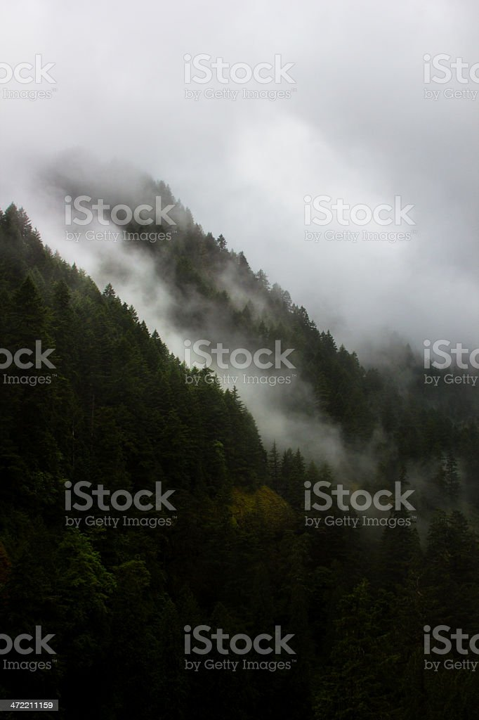 Storm clouds in mountain ravines stock photo
