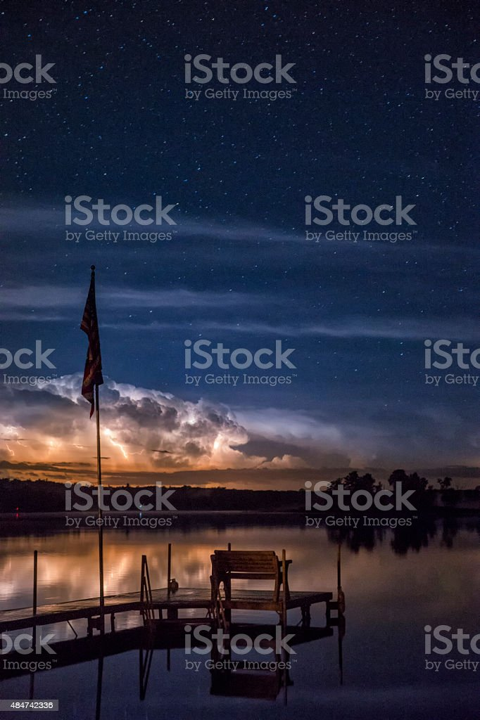 Storm clouds light up the sky stock photo