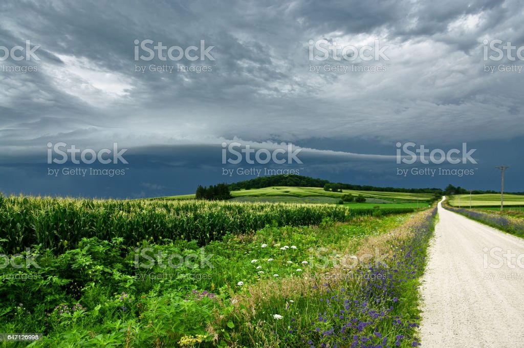 Storm Clouds Over a Country Road stock photo