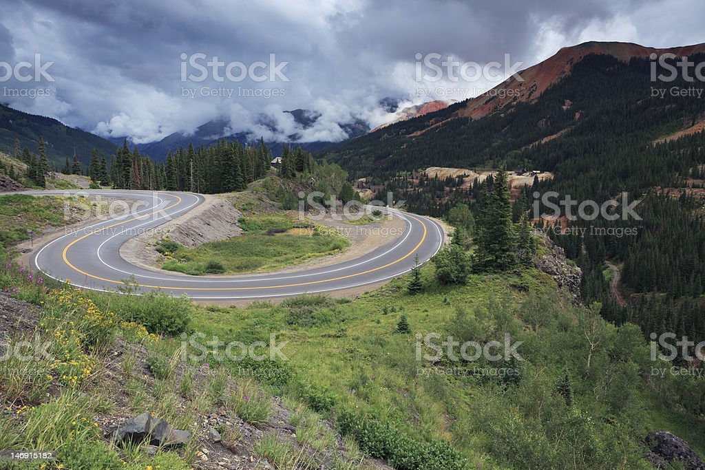Storm clouds over a mountain road in Colorado stock photo