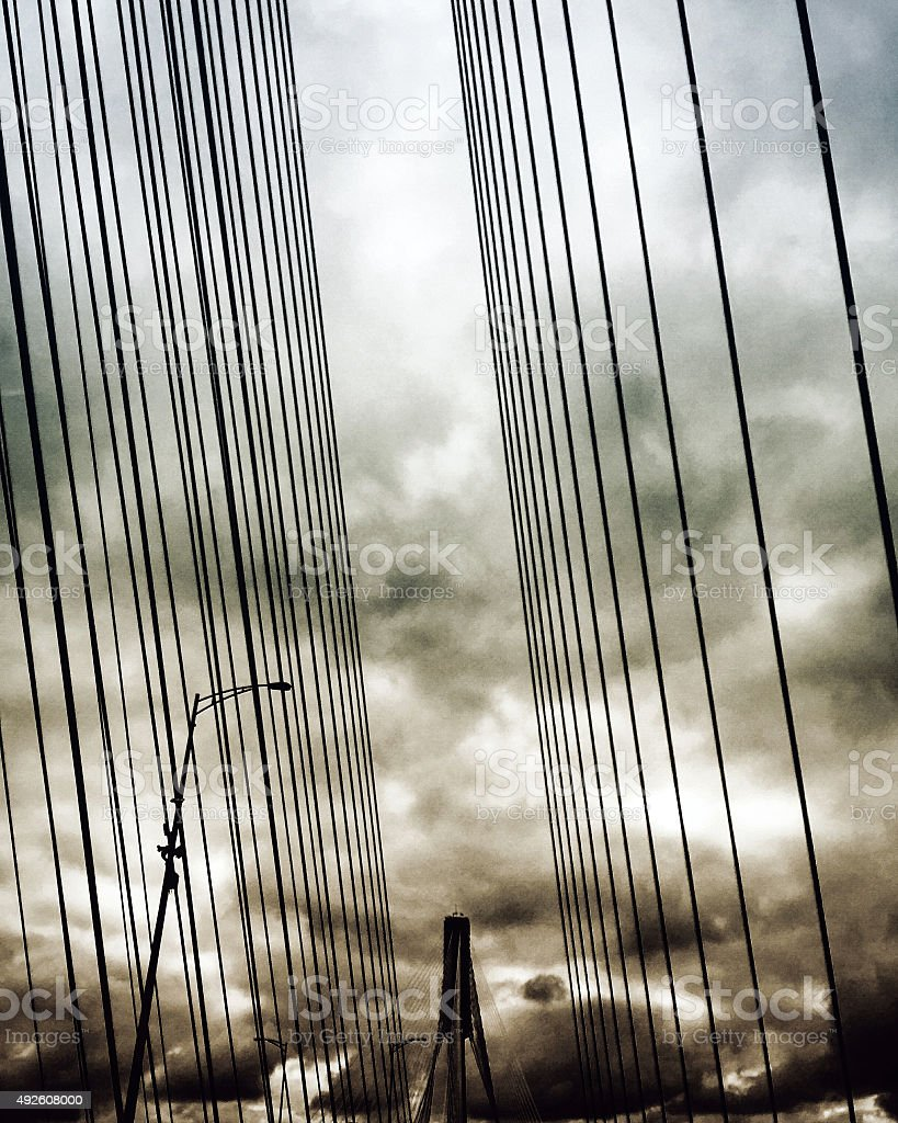 Storm clouds over bridge crossing royalty-free stock photo