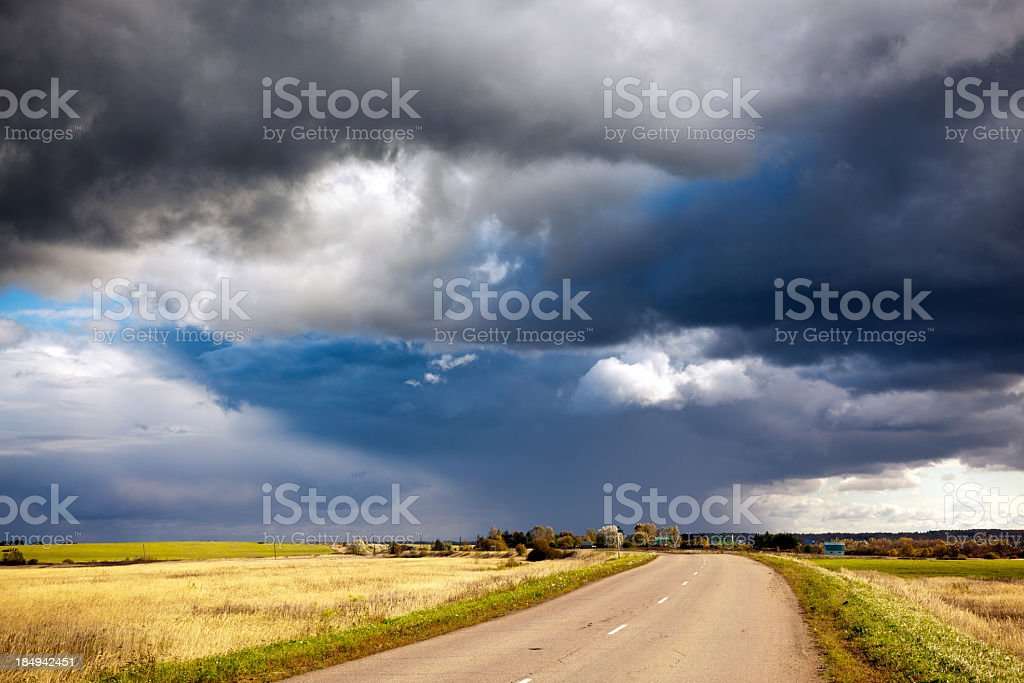 Storm clouds over country road royalty-free stock photo