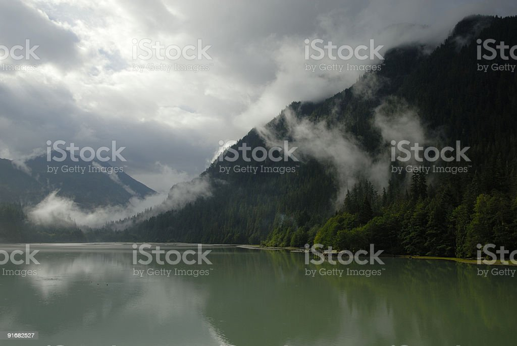 Storm clouds over Diablo Lake in North Cascades stock photo