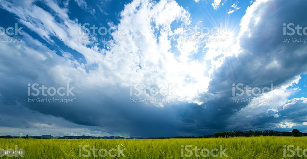 Storm clouds over empty field  stock photo