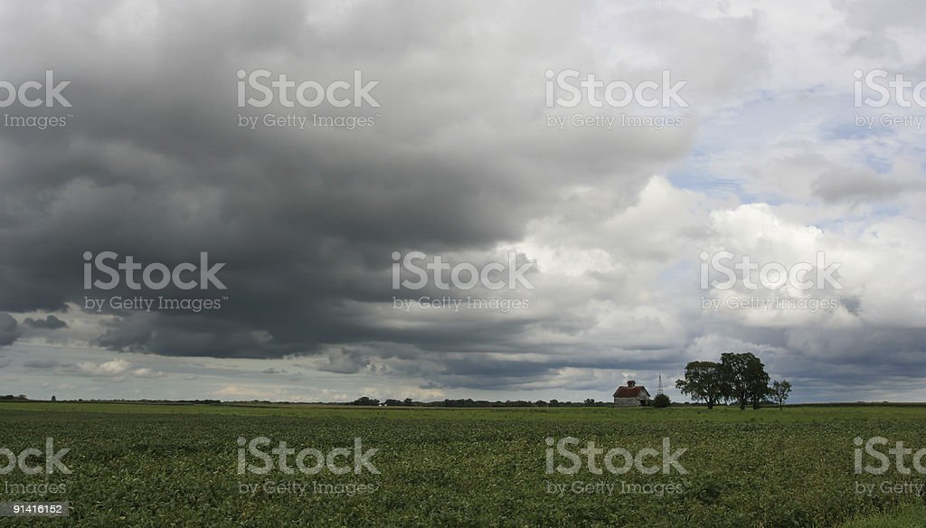 storm clouds over farm royalty-free stock photo