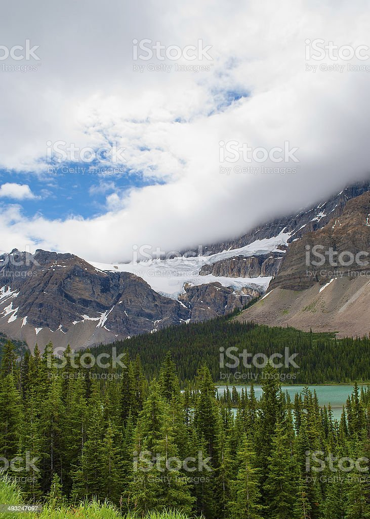 storm clouds over glacier stock photo