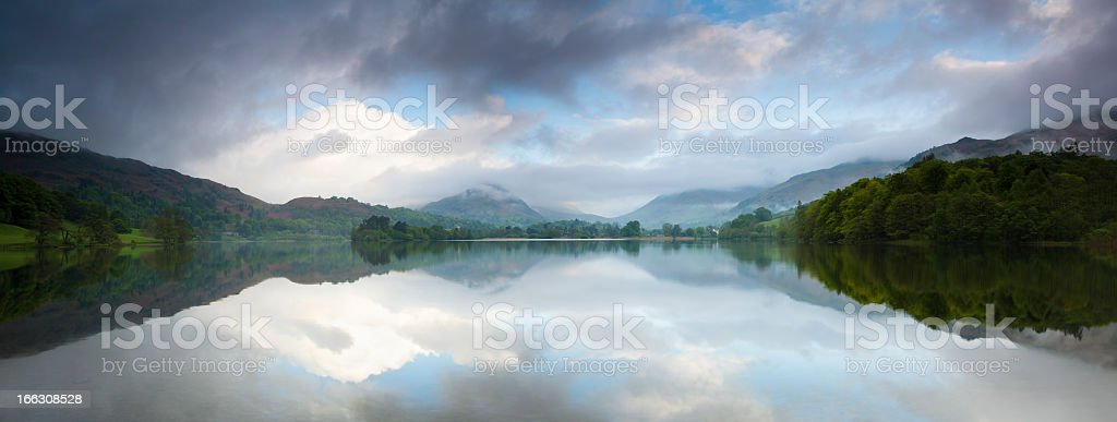 Storm Clouds over Lake Grasmere at Dawn stock photo