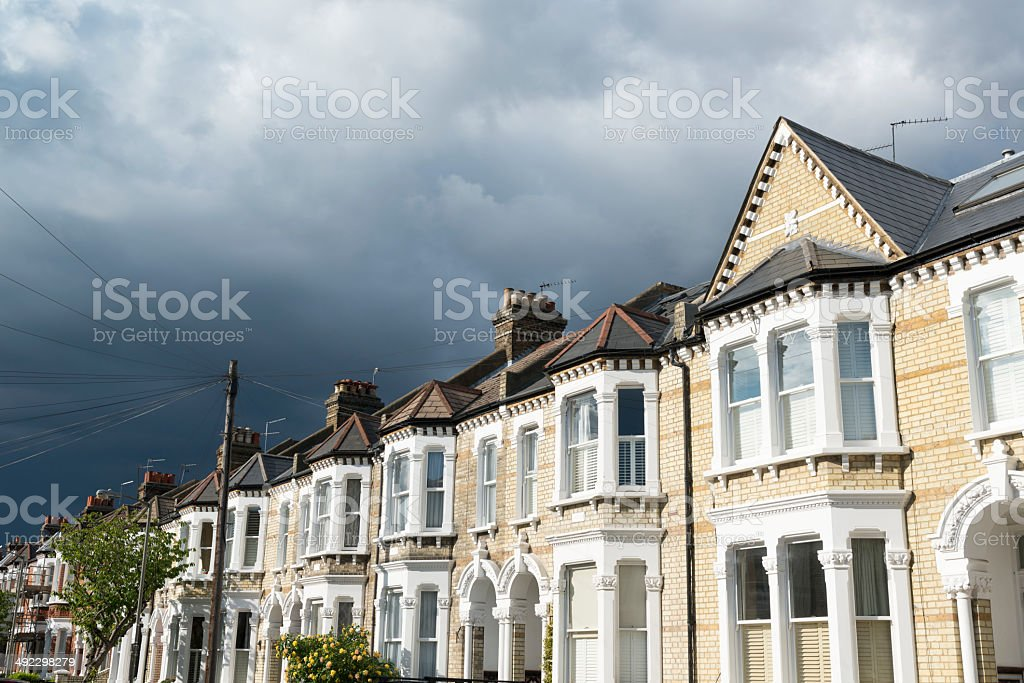 Storm clouds over London property stock photo