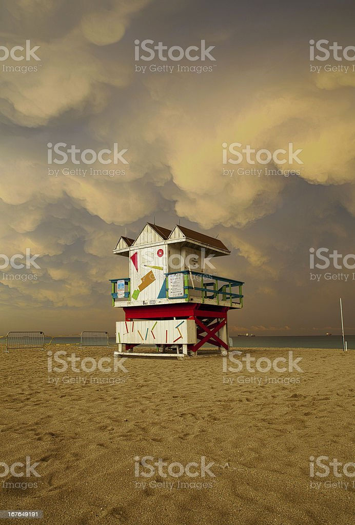 Storm clouds over Miami Beach Florida lifegurad house royalty-free stock photo